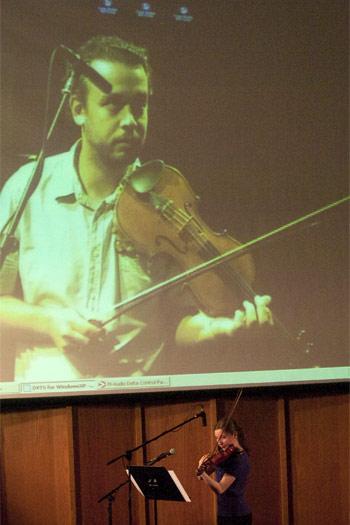 Manel Porta (on screen) teaches a lesson to recent NIU School of Music alumna Katelyn Kozinski via Internet 2.