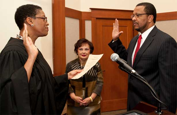 NIU Board of Trustees Chair Cherilyn G. Murer observes Wheeler G. Coleman's oath of office Thursday, Feb. 2