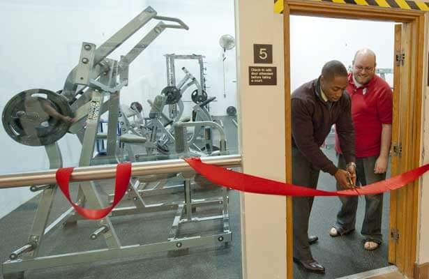 SA President Elliot Echols cuts the ribbon to a Rec Center fitness room as Senate Speaker Austin Quick looks on.