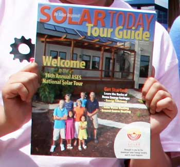 Photo of an Enhancing Engineering Pathways student holding a Solar Today magazine