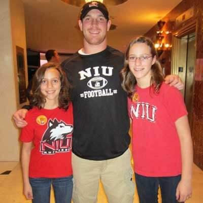 NIU Huskie fans Mindy (left) and Brianna Kramer meet quarterback Jordan Lynch.