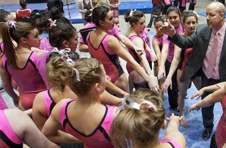 Sam Morreale and the NIU Huskie gymnastics team