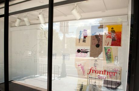 Photo of an art exhibit inside the Frontier window