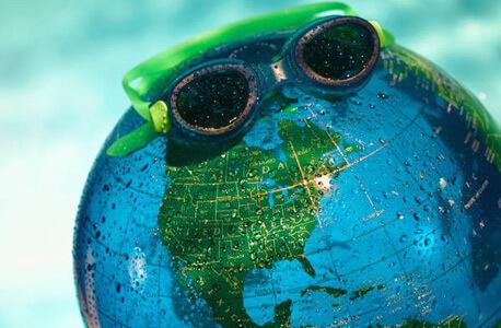 Photo of a globe wearing swim goggles