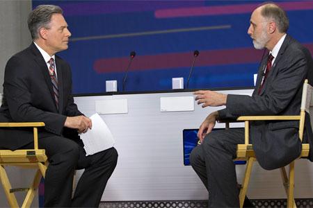 WTVO anchor Nick Toma interviews NIU President Doug Baker before the May 29 finals.