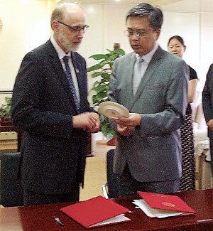 NIU President Doug Baker chats with Nankai University President Gong Ke.