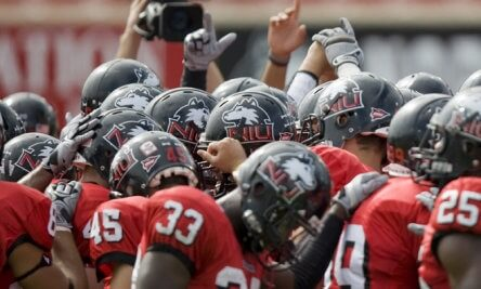 NIU Huskie football team huddles up