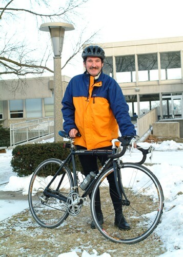 Setting a good example: Carpenter commutes on his bike to work – even in the winter – from suburban Batavia to DeKalb.