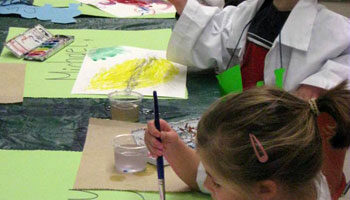 Art Express students work on paintings