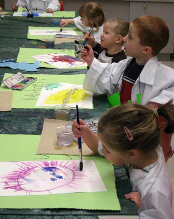 Art Express students work on paintings.