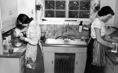NIU students work in the Home Management House circa 1960.