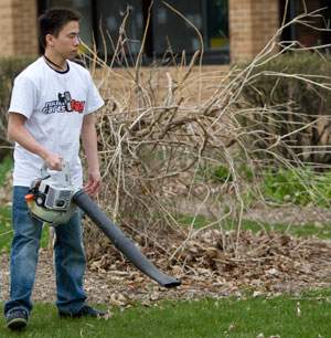 Blowing leaves on NIU Cares Day