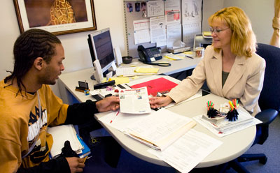 Frankie Benson (right) works with a student.