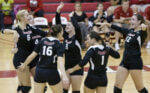 Volleyball team celebrates victory over Toledo