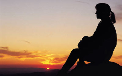 Photo of woman's silhouette against sunset