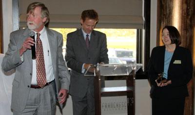 Paul Cain (left) speaks at the Partner in Peace award presentation