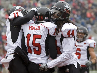 NIU football players celebrate