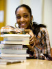 Photo of female student with books