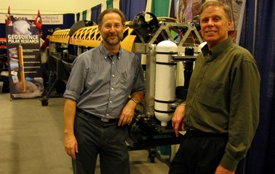 Reed Scherer (left) and Ross Powell in front of the newly built robotic submarine during its San Francisco unveiling.