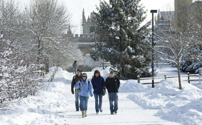 Students walk across the snowy NIU campus