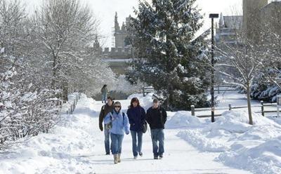 Students walk across the snowy NIU campus