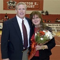Coach Dave Grant (with his wife, Kris) was honored before the meet.