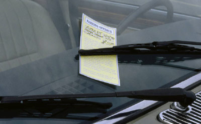 Photo of parking ticket on windshield