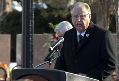 NIU President John G. Peters speaks Monday, Feb. 14, at the Presentation of the Memorial Wreaths.