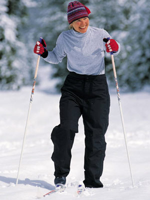 Photo of a woman cross-country skiing