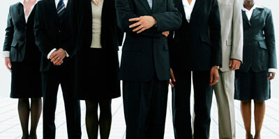 A photo of employees dressed for success