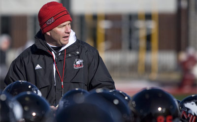NIU football coach Dave Doeren leads drills at a recent spring practice.