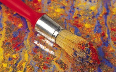 Photo of a paint brush on canvas