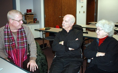 Grant Olson (left), Clark Neher and Arlene Neher reminisce about their Peace Corps experiences at a Jan. 28 Center for Southeast Asian Studies lecture about NIU's early connection to the program. (CSEAS photo)