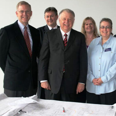 NIU President John G. Peters looks over construction plans with officials from Illinois Valley Community College.