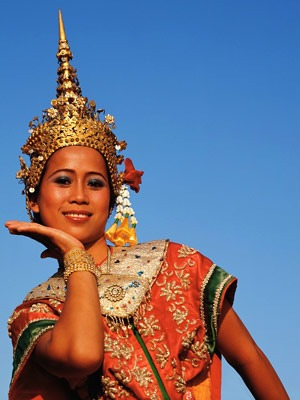 A photo of a woman in traditional Thai clothing