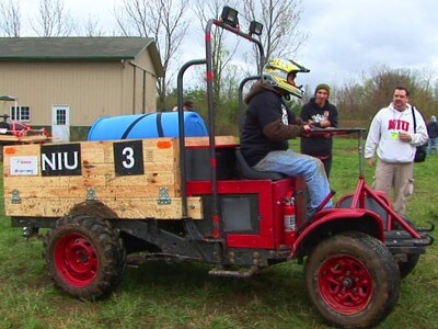 An NIU student demonstrates the university's entry into the 11th Annual Basic Utility Vehicle Competition.