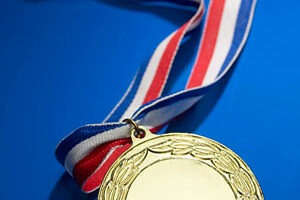 Photo of a medal on a red, white and blue ribon
