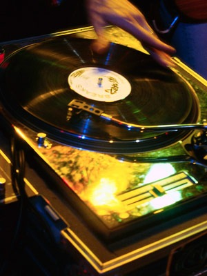 Photo of DJ spinning record on turntable