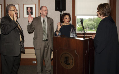 The Honorable Judge Robbin Stuckert administers the oath of office Thursday, May 12, to new NIU Trustee Robert T. Marshall (left) and returning trustees Marc J. Strauss and Cherilyn G. Murer.