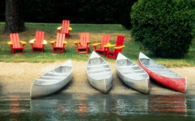 Photo of canoes on a river bank