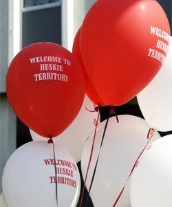 "Photo of red and white ""Welcome to Huskie Territory"" balloons"