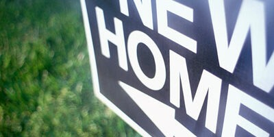 "Photo of a ""New Home"" sign"