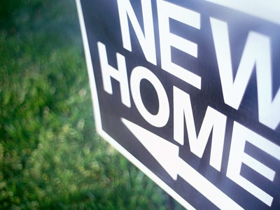 """Photo of a """"New Home"""" sign"""