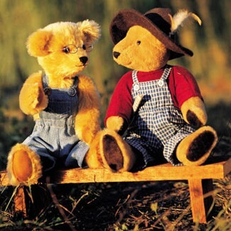 Photo of teddy bears on a bench
