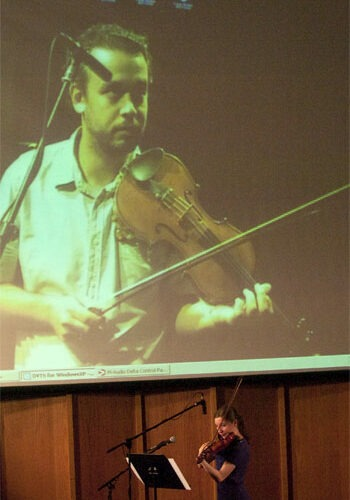 Manel Porta (on screen) teaches a lesson to recent NIU School of Music alumna Katelyn Kozinski via Internet 2.