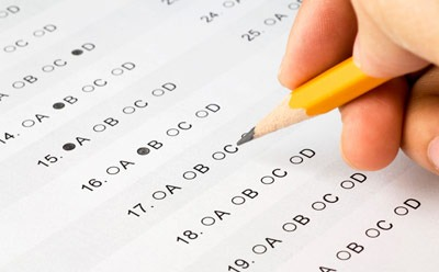Photo of a person taking a test with a No. 2 pencil
