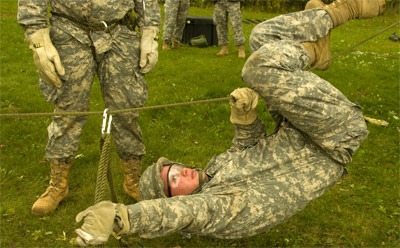 Photo of an NIU Army ROTC cadet in training exercises.