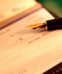 Photo of check and pen