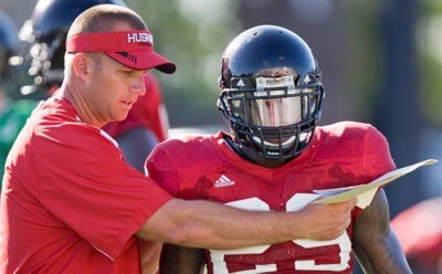 Coach Dave Doeren and linebacker Jorden Delegal