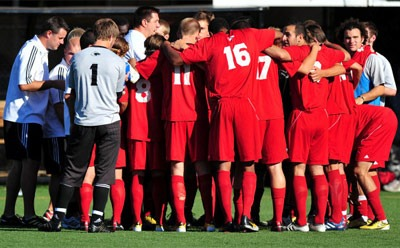 NIU men's soccer team huddle